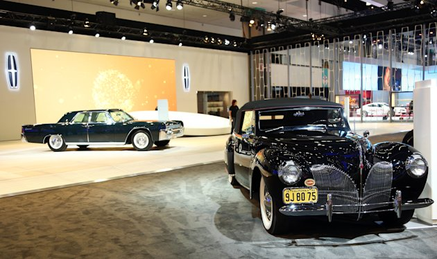 1940 Lincoln Continental Cabriolet, right, and the 1961 Lincoln Continental Sedan are seen as part of Lincoln's Heritage on Display at the Los Angeles Auto Show press day, Wednesday, Nov. 28, 2012 in