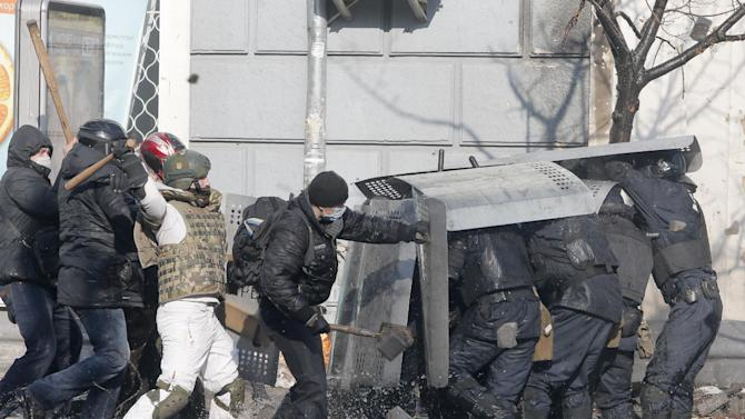 Anti-government protesters clash with riot police outside Ukraine's parliament in Kiev, Ukraine, Tuesday, Feb. 18, 2014. Thousands of angry anti-government protesters clashed with police in a new eruption of violence following new maneuvering by Russia and the European Union to gain influence over this former Soviet republic. (AP Photo/Efrem Lukatsky)