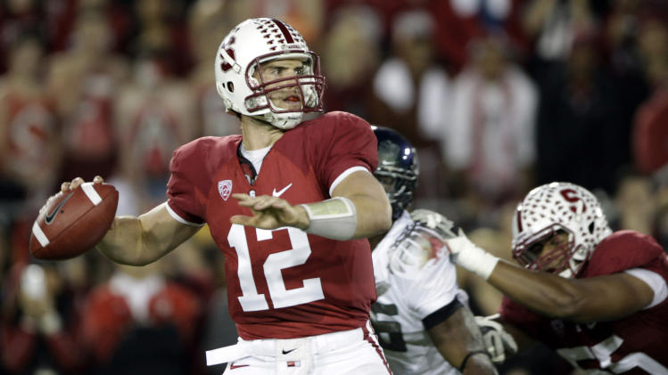 Stanford quarterback Andrew Luck (12) passing against Oregon in the first quarter of an NCAA college football game in Stanford, Calif. A person with direct knowledge of the situation says the Indianapolis Colts are taking Luck with the No. 1 pick in next week's NFL draft. (AP Photo/Paul Sakuma, File)