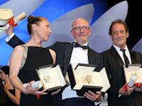 French actress Emmanuelle Bercot (L), French director Jacques Audiard (C) and French actor Vincent Lindon pose on stage after their prizes at the closing Cannes Film Festival ceremony