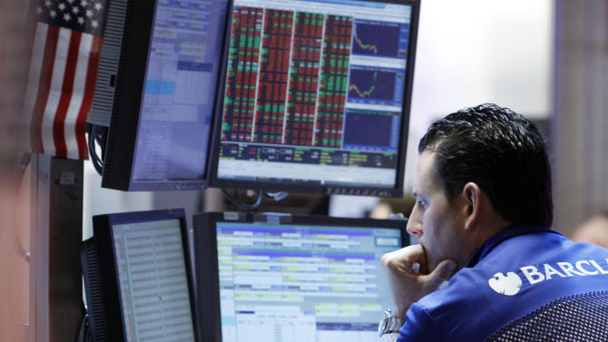 In a Monday, May 7, 2012, photo, specialist Stephen D'Agostino works at his post on the floor of the New York Stock Exchange. Wall Street was headed for a lower opening Wednesday May 16, 2012, with Dow Jones industrial futures losing 0.1 percent and S&P 500 futures down 0.2 percent.   (AP Photo/Richard Drew)