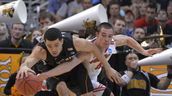 Wichita State's Fred Van Vleet, left, and Ohio State guard Aaron Craft chase a loose ball during the second half of the West Regional final in the NCAA men's college basketball tournament, Saturday, March 30, 2013, in Los Angeles. (AP Photo/Mark J. Terrill)