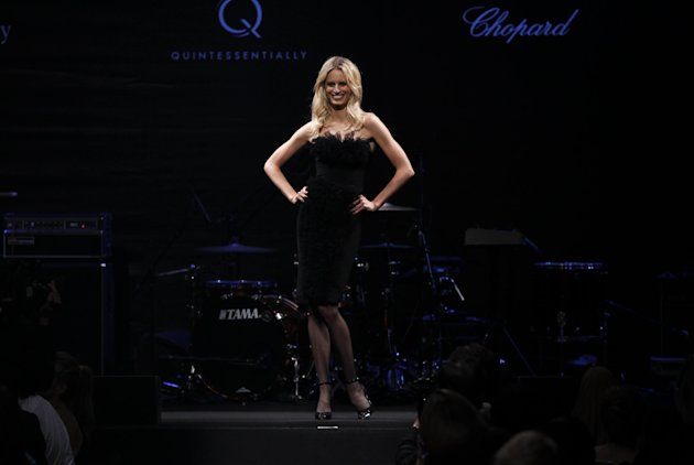 Karolina Kurkova models during the auction for the amfAR Cinema Against AIDS benefit during the 65th Cannes film festival, in Cap d'Antibes, southern France, Thursday, May 24, 2012. (AP Photo/Joel Ryan)
