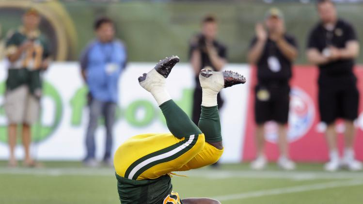 Eskimos' Sewell celebrates sack against RedBlacks during their CFL football game in Edmonton