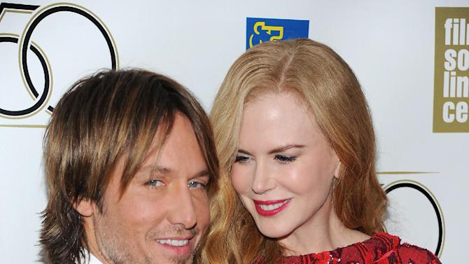 "Actress Nicole Kidman and her husband Keith Urban attend the premiere of ""The Paperboy"" during the 2012 New York Film Festival at Alice Tully Hall on Wednesday Oct. 3, 2012 in New York. (Photo by Evan Agostini/Invision/AP)"