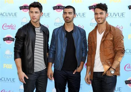 The Jonas Brothers pose as they arrive at the Teen Choice Awards at the Gibson amphitheatre in Universal City