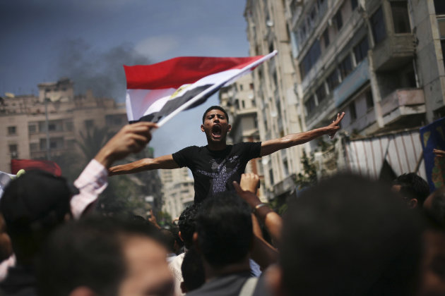 An Egyptian protester chants slogans against presidential candidate Ahmed Safiq during a demonstration against the Supreme Constitutional Court rulings in Alexandria, Egypt, June 15, 2012.  Judges app