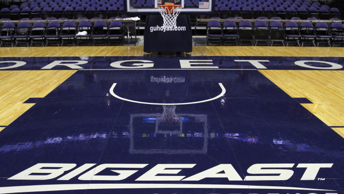 A Big East Conference logo is displayed on the court after Georgetown played Western Carolina in an NCAA college basketball game at the Verizon Center in Washington, on Saturday, Dec. 15, 2012. The seven Big East schools that don't play FBS football have decided to leave the conference and pursue a new basketball framework.  The seven schools are: Georgetown, St. John's, Villanova, DePaul, Marquette, Seton Hall and Providence. (AP Photo/Jacquelyn Martin)