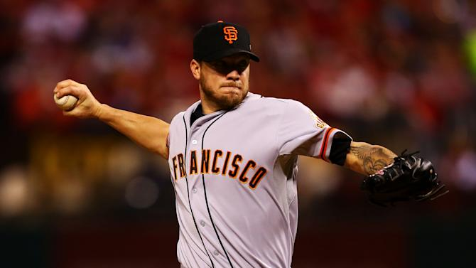 Jake Peavy of the San Francisco Giants pitches in the first inning against the St. Louis Cardinals during Game Two of the National League Championship Series on October 12, 2014 in St Louis, Missouri
