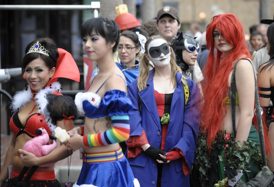 Costumed characters wait in line for a photo shoot in downtown San Diego near the Comic-Con International 2011 convention held in San Diego Thursday, July 21, 2011. The annual comic book and popular arts convention attracts over 100,000 people and runs through Sunday July 24.  (AP Photo/Denis Poroy)