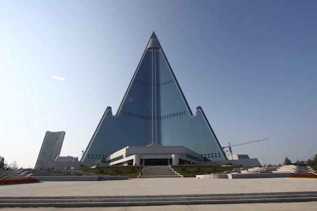 In this Sept. 23, 2012 photo released by Koryo Group on Wednesday, Sept. 26, 2012, the pyramid-shaped, 105-story Ryugyong Hotel stands in Pyongyang, North Korea. A foreign tour agency said the interio
