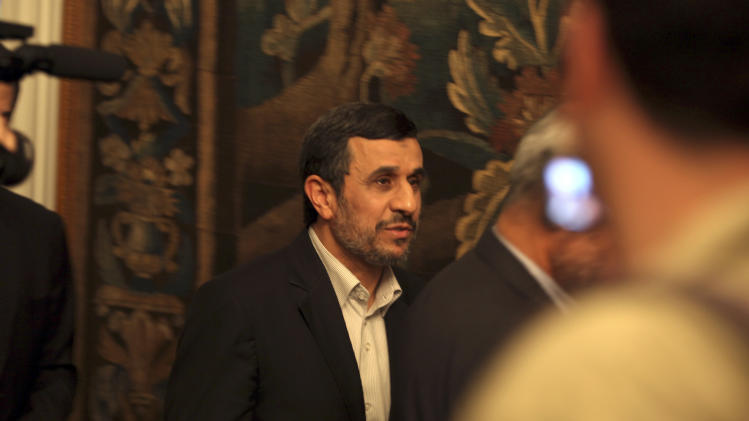 Iran's President Mahmoud Ahmadinejad, leaves a press conference in Cairo, Egypt, Thursday Feb. 7, 2013. Ahmadinejad says his country cannot hold meaningful talks with the U.S. on Tehran's disputed nuclear program if Washington is threatening his country.(AP Photo/Khalil Hamra)
