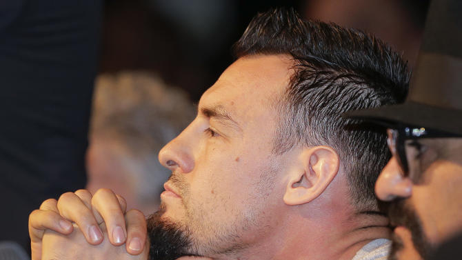 Boxer Robert Guerrero listens to comments during a news conference, Wednesday, May 1, 2013, in Las Vegas. Guerrero will challenge Floyd Mayweather Jr. for Mayweather's WBC welterweight title on Saturday. (AP Photo/Julie Jacobson)