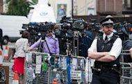 <p>Press and police stand outside the Ecuadorian Embassy in London on August 17. Embattled WikiLeaks founder Julian Assange is set to face the world's media on Sunday from the safe haven of the embassy but risks arrest if he takes even one step out of the building.</p>