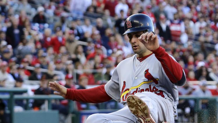 St. Louis Cardinals' Pete Kozma slides across home plate for a run on a sacrifice fly by Carlos Beltran in the third inning of Game 4 of the National League division baseball series against the Washington Nationals on Thursday, Oct. 11, 2012, in Washington. (AP Photo/Alex Brandon)