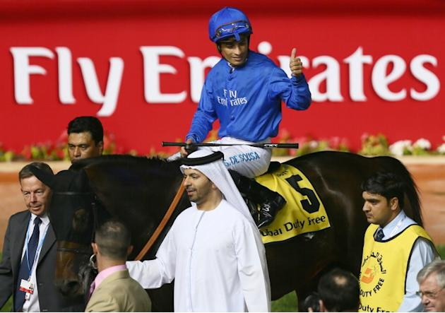 Jockey Silvester De Sousa on Sajjhaa, owned by the Godolphin stables, celebrates his win in the Dubai Duty Free part of the Dubai World Cup meet, the world's richest race, at Meydan race track in Duba