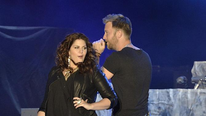 """FILE - In this Saturday, April 27, 2013 file photo, singer Hillary Scott, left, and singer Charles Kelley of the band Lady Antebellum perform on Day 2 of the 2013 Stagecoach Music Festival at the Empire Polo Club, in Indio, Calif. NBC says it's lining up musical artists including Rod Stewart to perform on """"The Voice"""" in May. The network said Monday, April 29, 2013, that Stewart, CeeLo Green, Lady Antebellum, Robin Thicke, Pharrell Williams and T.I. will take the stage on upcoming episodes of the hit singing contest. (Photo by Dan Steinberg/Invision/AP, File)"""