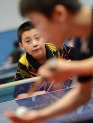Yu Zhengyang, 10, seen during table tennis training session at the Shichahai Sports School in Beijing. China's status as a sporting superpower was achieved on the back of intense state-led training in schools, but the current crop of coaches and students say there is life outside the sports halls