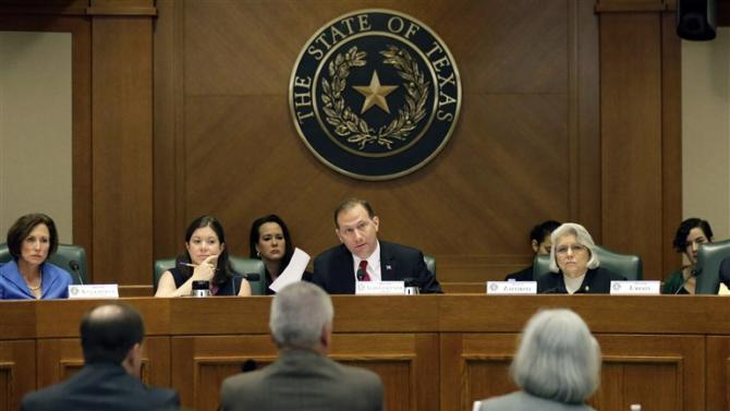 FILE- In this July 29, 2015, photo, Sen. Charles Schwertner, R-Georgetown, center, questions witnesses during a Texas Texas Senate Health and Human Services Committee hearing on Planned Parenthood videos covertly recorded that target the abortion provider in Austin, Texas. Texas is one of a number of GOP-controlled states that have launched investigations after the release of videos in which Planned Parenthood officials discuss how to harvest tissue for research from aborted fetuses.(AP Photo/Eric Gay, File)