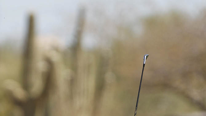 Jiyai Shin, of South Korea, follows through on her approach shot on the ninth fairway during the first round of the Founders Cup golf tournament on Thursday, March 14, 2013, in Scottsdale, Ariz. (AP Photo/Paul Connors)