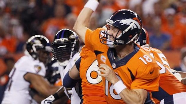 Denver Broncos quarterback Peyton Manning passes against the Baltimore Ravens (Reuters)