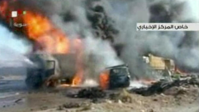 This image made from video made from Syrian state television shows the aftermath of a truck bomb attack in Hama, Syria, Oct. 20, 2013. Syria's state media and activists say the suicide truck bomb attack on a government checkpoint on the edge of the central city left more than two dozen people dead. The state news agency SANA said Syrian rebels drove the truck laden with over a ton of explosives into the post at the eastern entrance of the city on Sunday. (AP Photo/Syrian State television via AP video)