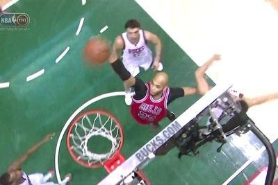 Taj Gibson throws down a huge dunk and hangs on the rim FOREVER