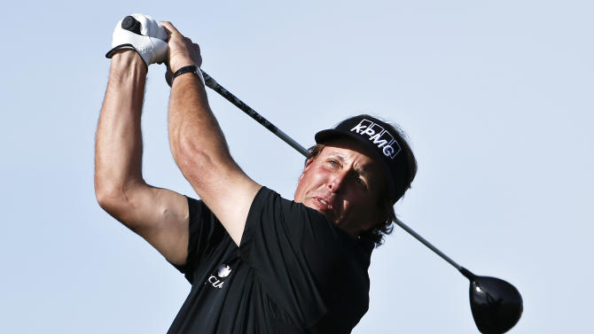 Phil Mickelson hits his tee shot on the 15th hole during the first round of the Waste Management Phoenix Open golf tournament Thursday, Jan. 31, 2013, in Scottsdale, Ariz. (AP Photo/Ross D. Franklin)