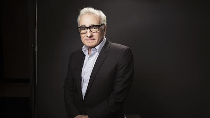 This Dec. 15, 2013 photo shows American film director Martin Scorsese in New York. Scorsese's portrait of Wall Street excess has been judged by some critics and moviegoers as a glorification of unchecked greed. But the movie's bad reputation as an orgy of drugs, sex and money has also drawn eager crowds. (Photo by Victoria Will/Invision/AP)