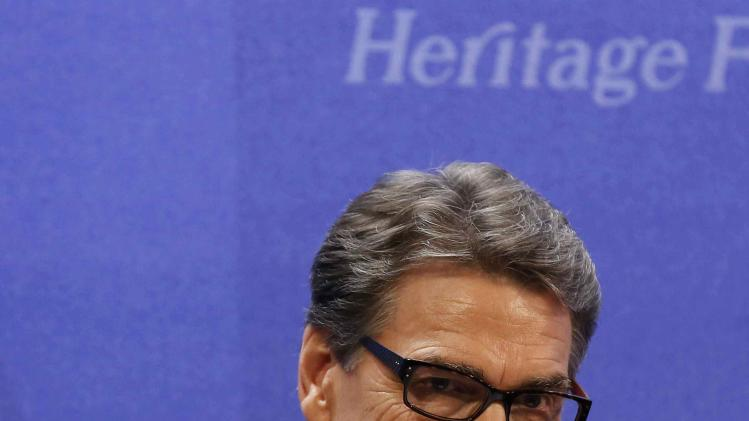 Texas Governor Rick Perry makes a point as he speaks about immigration while at the Heritage Foundation in Washington