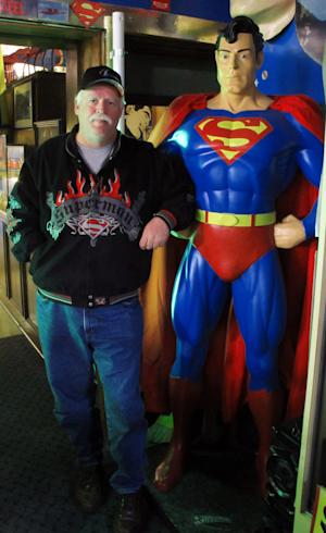 In this Dec. 9, 2010, photo Superman Museum owner Jim Hambrick poses with a statue of the Man of Steel in Metropolis, ILL., the far southern Illinois town along the Ohio River that considers Superman its favorite son. The town's has become the nexus  of a lingering labor dispute between a Honeywell plant that helps turn radioactive uranium into eventual fuel for nuclear power and its roughly 230 union workers the company has locked out since June. (AP Photo/Jim Suhr)