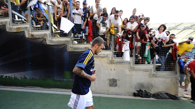 CARSON, CA - JULY 19: David Beckham #23 of the Los Angeles Galaxy runs out to the pitch as fans cheer him on before the MLS game against AC Milan at The Home Depot Center on July 19, 2009 in Carson, California. (Photo by Kevork Djansezian/Getty Images)