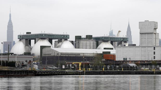 This Oct. 24, 2012 photo shows one of New York's 14 wastewater treatment plants, they city's biggest and newest, on Newtown Creek. During heavy rainstorms, when the treatment plants reach capacity, raw sewage and wet garbage spill into the creek thorough hundreds of pipes on its banks. (AP Photo/Mary Altaffer)