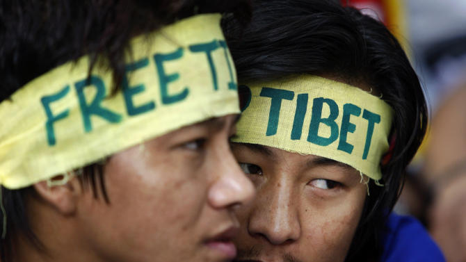 Exiled Tibetans wear headbands during a rally to mark World Human Rights Day in New Delhi, Monday, Dec. 10, 2012. At least 86 people have set themselves on fire since 2009. (AP Photo/Tsering Topgyal)