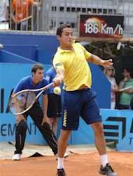 Spain's Nicolas Almagro backhands the ball to France's Gilles Simon during their semi-final match at the Nice ATP tennis tournament, Friday May 25, 2012, southern France.(AP Photo/CHrsitian Alminana)