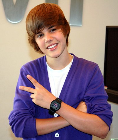 Justin Bieber shows his love in 2009, but he isn't so photo friendly now.