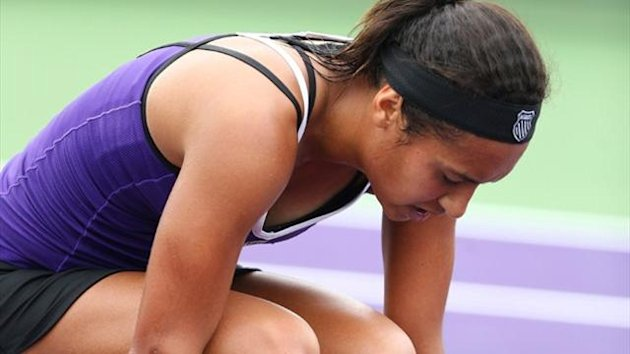 Heather Watson reacts after losing a match