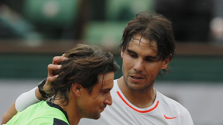 Spain's Rafael Nadal greets compatriot David Ferrer after defeating Ferrer in three sets 6-3, 6-2, 6-3, in the final of the French Open tennis tournament, at Roland Garros stadium in Paris, Sunday June 9, 2013. (AP Photo/Michel Spingler)