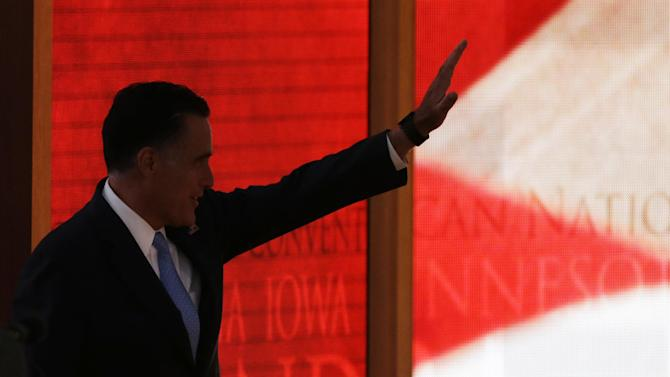 Republican presidential nominee Mitt Romney waves before leaving the stage after a sound check before the Republican National Convention in Tampa, Fla., on Thursday, Aug. 30, 2012. (AP Photo/Charlie Neibergall)
