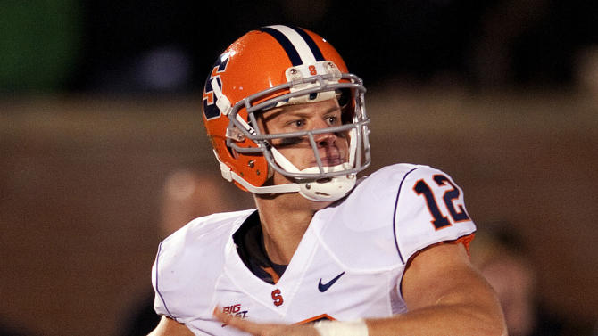 FILE - In this Nov. 17, 2012, file photo, Syracuse quarterback Ryan Nassib throws a pass during the second half of an NCAA college football game against Missouri in Columbia, Mo. Nassib was drafted by the New York Giants in the fourth round of the NFL Draft on Saturday, April 27, 2013.  (AP Photo/L.G. Patterson, File)