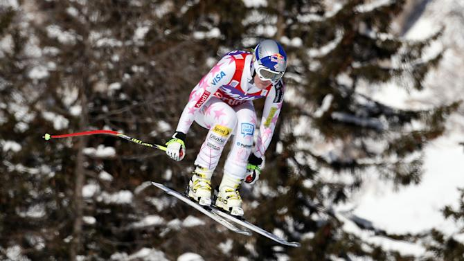 Lindsey Vonn, of the United States, speeds down the course on her way to win an Alpine Ski World Cup women's downhill, in Cortina D'Ampezzo, Italy, Saturday, Jan.19, 2013. (AP Photo/Marco Trovati)