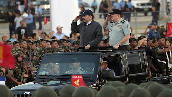 Ortega and Aviles attend a military parade in Managua