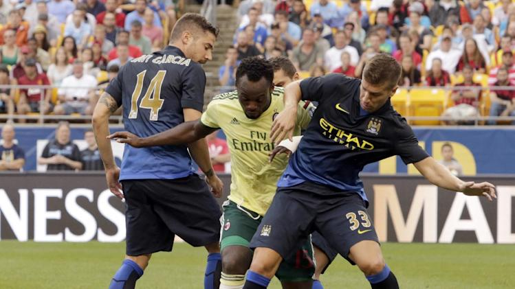 IMAGE DISTRIBUTED FOR GUINNESS INTERNATIONAL CHAMPIONS CUP - AC Milan's Michael Essien (15) battles for the ball with Manchester City's Javi Garcia (14), Matija Nastasic (33) and Jack Rodwell (17) is seen during Guinness International Champions Cup game against Manchester City vs. AC Milan, on Sunday, July 27, 2014 at Heinz Field in Pittsburgh, Pa. Manchester City won the match 5-1. (Ed Rieker/AP Images for Guinness International Champions Cup)