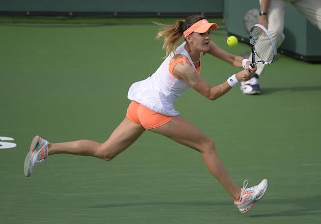 Agnieszka Radwanska, of Poland, runs down a shot from Alize Cornet, of France, at the BNP Paribas Open tennis tournament, Tuesday, March 11, 2014, in Indian Wells, Calif