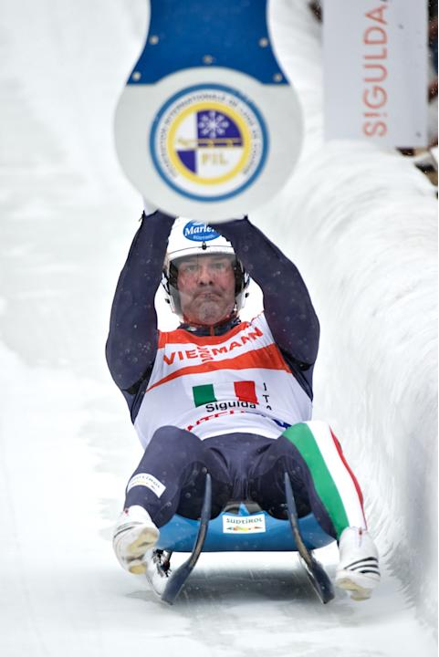 Italy's Armin Zoggeler hits the relay target in the Luge Team Relay event of the Luge World Cup in Latvias town of Sigulda on February 19, 2012. Russia won the race ahead of second-placed Austria and