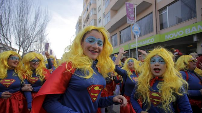 Carnival revellers march during the carnival parade in Torres Vedras