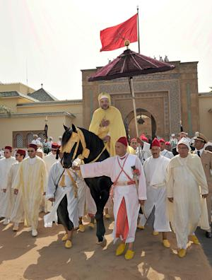 "FILE - In this Aug. 21, 2012 file photo photo provided by the Moroccan Royal Palace, Moroccan King Mohammed VI seen while riding a horse during a ceremony of allegiance in Rabat, Morocco. Every year, hundreds of civil servants and elected officials from all over the country must gather at one of King Mohammed VI's palaces to pledge allegiance to the ""Commander of the Faithful"" in a tribute that critics say is increasingly outdated. The subservience points to the contradictions in a nation that quelled Arab Spring protests by promising the people a greater voice.  (AP Photo/ Azzouz Boukallouch, Moroccan Royal Palace, file)"