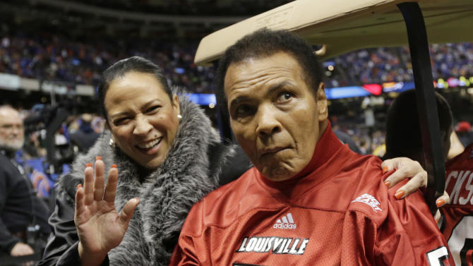FILE - In this Jan. 2, 2013, file photo, former boxing legend Muhammad Ali arrives at the Sugar Bowl football game in New Orleans. Muhammad Ali's daughter knocked down rumors of her father being near death Sunday, Feb. 3, 2013, saying he was at home watching NFL football's Super Bowl. (AP Photo/Dave Martin, File)