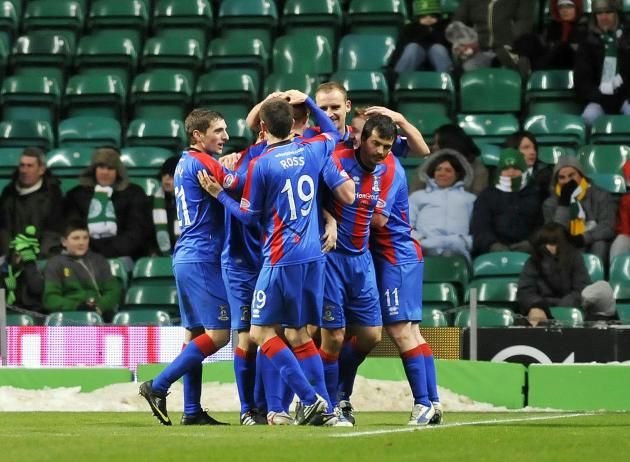 Inverness players celebrate their late e