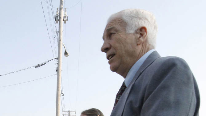 Former Penn State University assistant football coach Jerry Sandusky, right, arrives at the Centre County Courthouse with his wife Dorothy, left, in Bellefonte, Pa., Thursday, June 21, 2012. Sandusky is charged with 51 counts of child sexual abuse involving 10 boys over a period of 15 years.  (AP Photo/Gene J. Puskar)